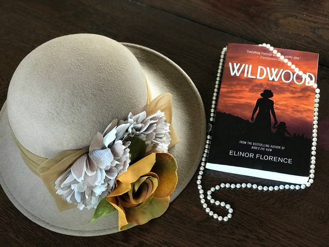 Wildwood, written by Elinor Florence, with the author's pioneer hat and pearls