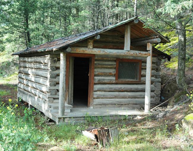 Log cabin before restoration, front