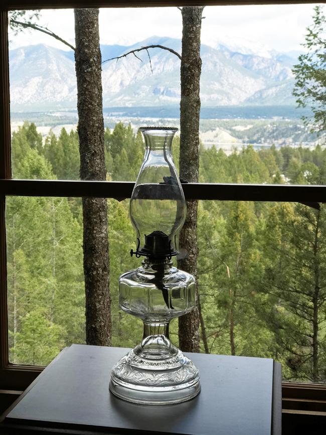log cabin, lamp in window