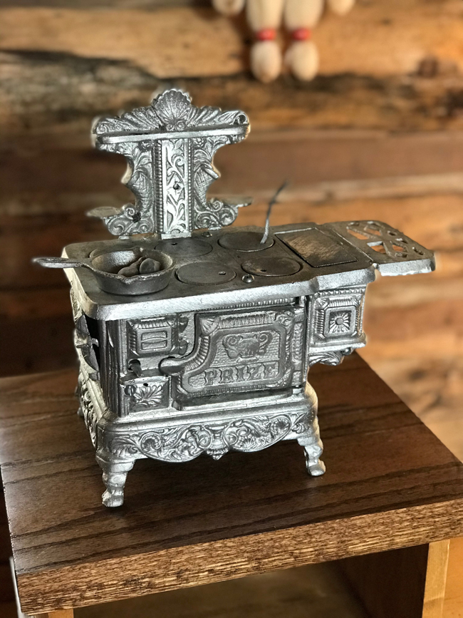 log cabin, miniature toy stove