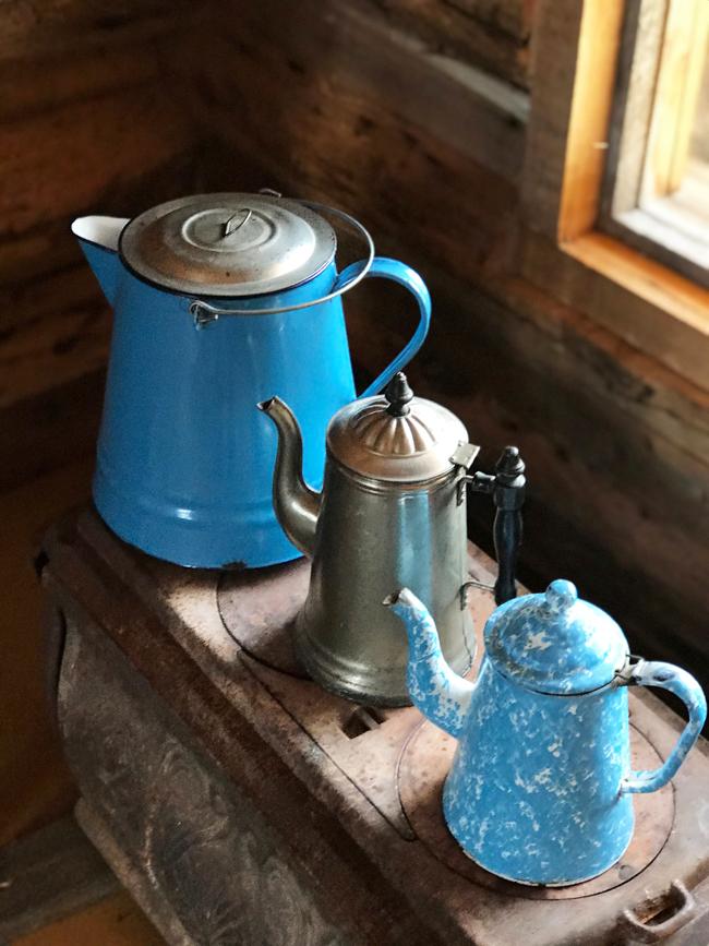 log cabin, three coffeepots