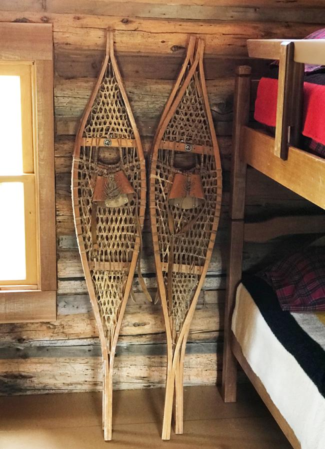 log cabin, vintage snowshoes