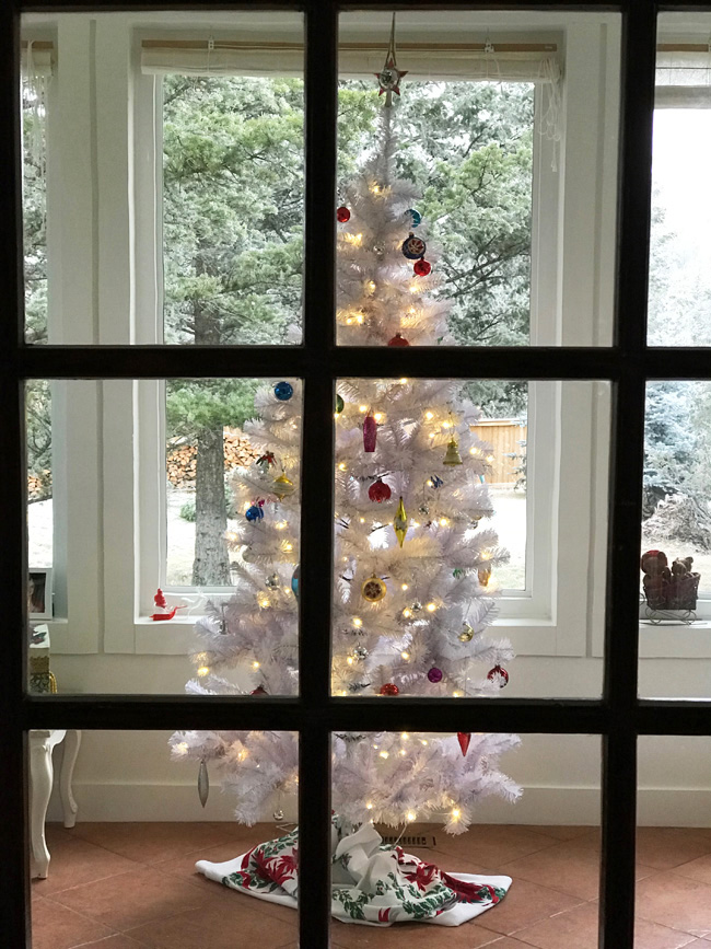 white Christmas tree with vintage ornaments