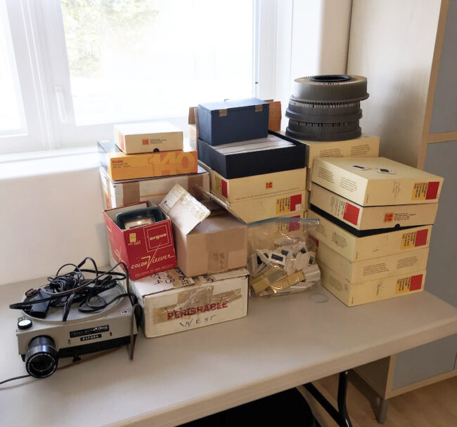 slide projector and pile of slide carousels