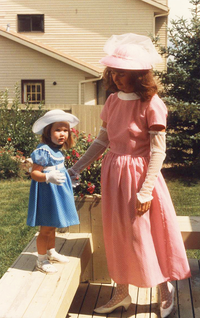 Mother and daughter in matching pink and blue dresses