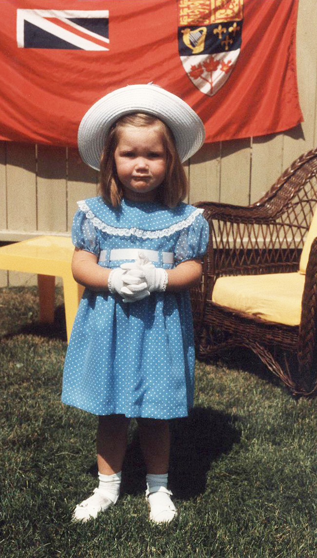 Little girl in blue dress, white hat and gloves
