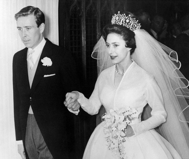 Princess Margaret in white gown leaves church with Anthony Armstrong-Jones