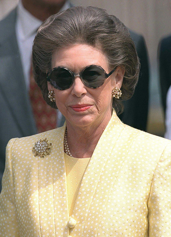 Princess Margaret in yellow suit and sunglasses
