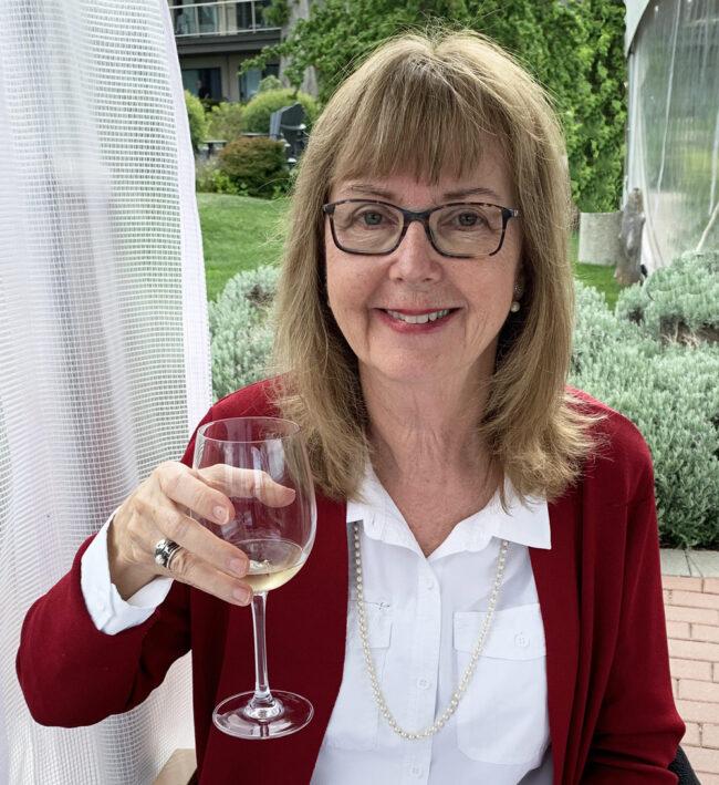Author Elinor Florence holds wine glass