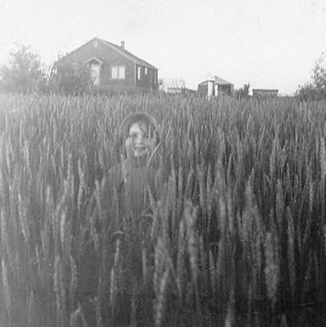 Author Elinor Florence in wheat field, 1954