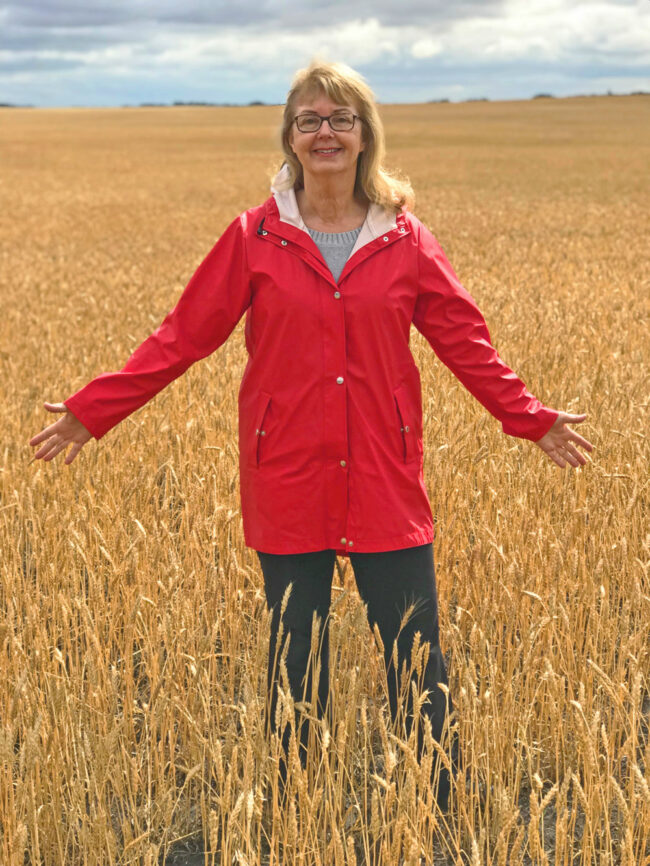 Author Elinor Florence standing in wheat field